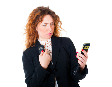 Young business woman with two mobile phones